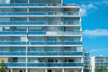 Одно из самых известных зданий Eco-Viikki — это «Дом с солнечными батареями»